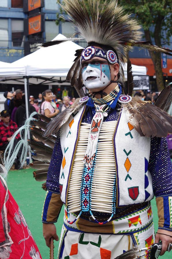 Colorful costume of a Pow-wow dancer stock photo