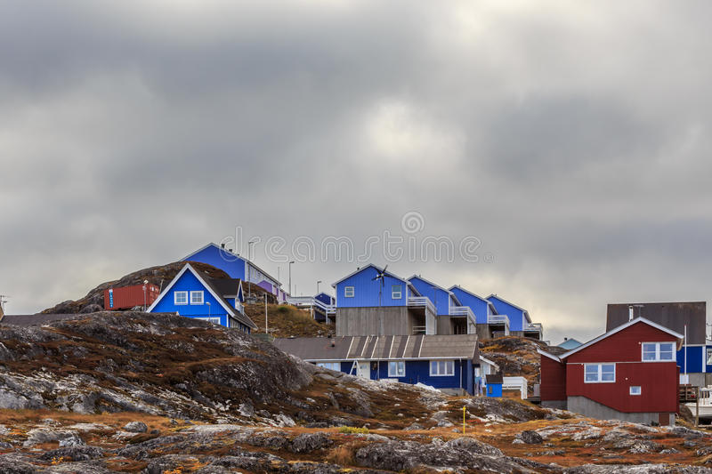 Colorful cottages hidden among the stones stock images