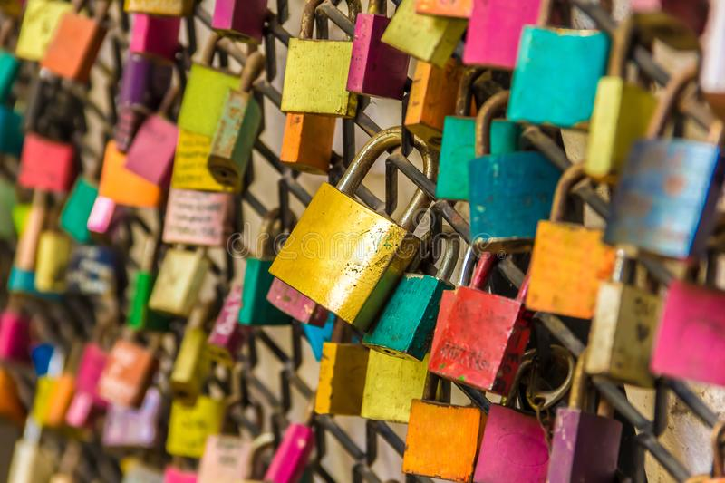 Colorful couple love padlocks attached. Colorful symbolic couple love padlocks attached to railings. Valentine's day concept royalty free stock photos