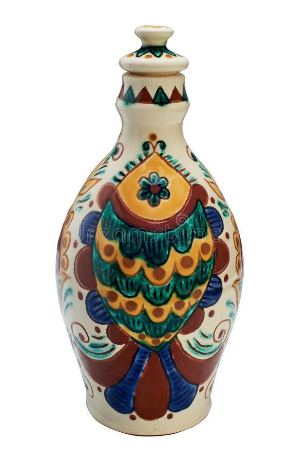 Colorful covered with glaze ceramic handmade bottle. Painting in the technique Kosovo ceramics - it really authentic, Ukrainian technique of painting on clay stock photos