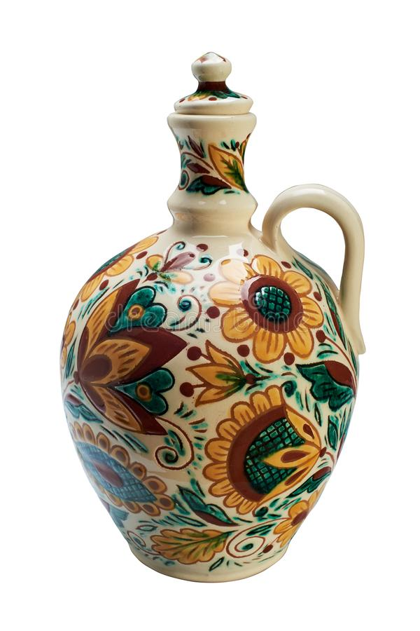 Colorful covered with glaze ceramic handmade bottle. Painting in the technique Kosovo ceramics - it really authentic, Ukrainian technique of painting on clay stock images