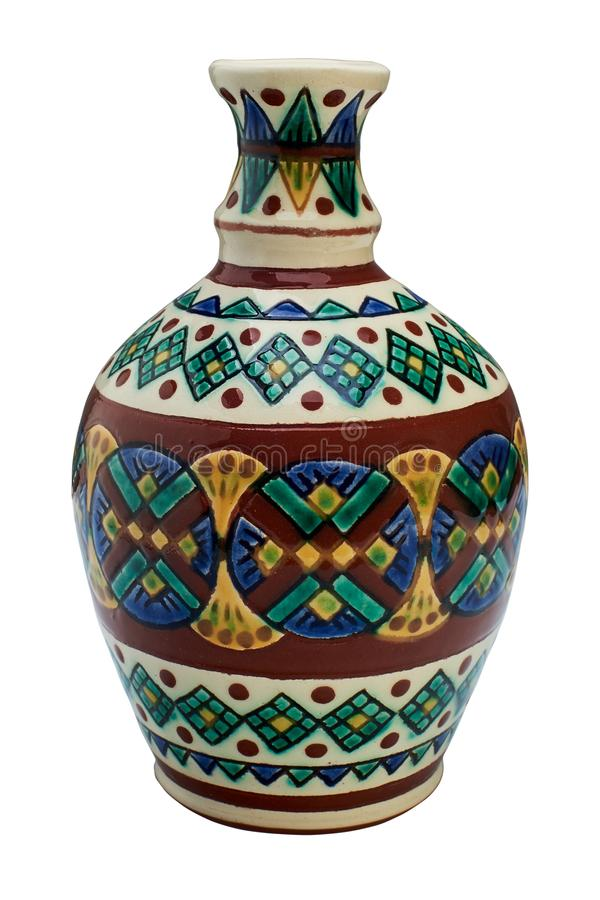 Colorful covered with glaze ceramic handmade bottle. Painting in the technique Kosovo ceramics - it really authentic, Ukrainian technique of painting on clay stock photography