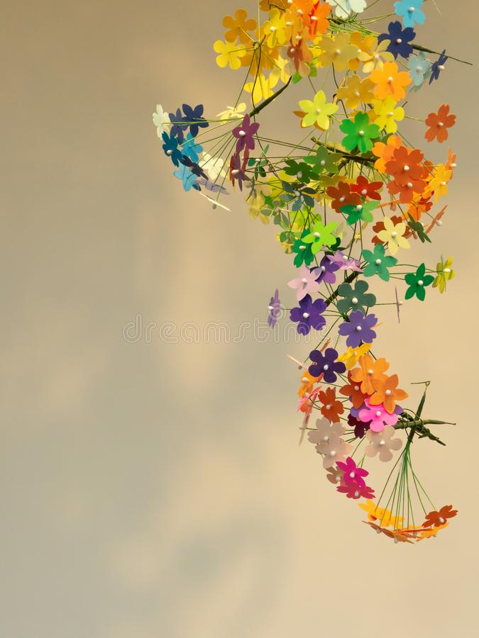 Colorful craft paper flowers garland. The color paper craft flowers for home decorate, wall decorate stock photography