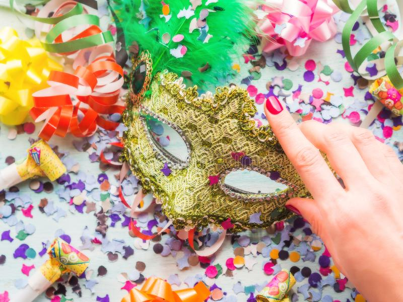 Colorful cranival Mardi gras background. With masquerade carnival mask and confetti, streamers, bows. Party items royalty free stock photos