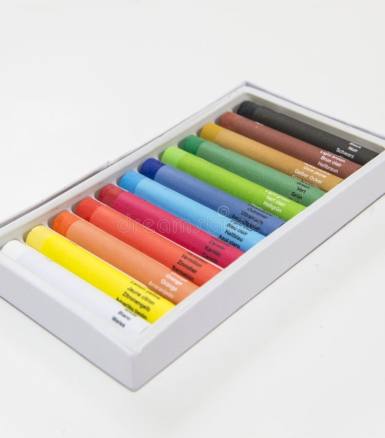 Colorful crayon set with named colors and color codes diagonal. High definition picture of a box of colorful crayons stock images