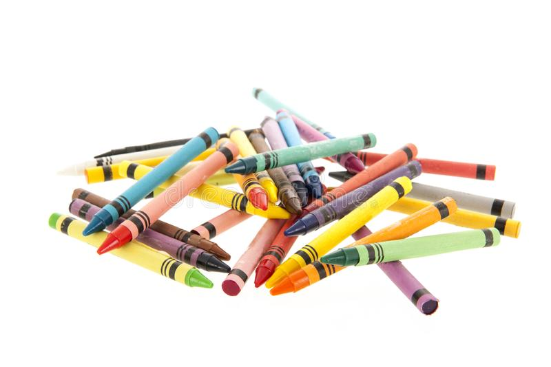 Colorful crayons isolated over white. Many colorful crayons isolated over white background royalty free stock photography