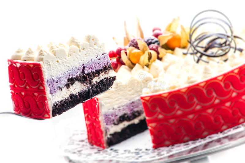 Colorful cream cake with chocolate swirls, patisserie, sweet dessert, photography for shop, delicious birthday cake royalty free stock images