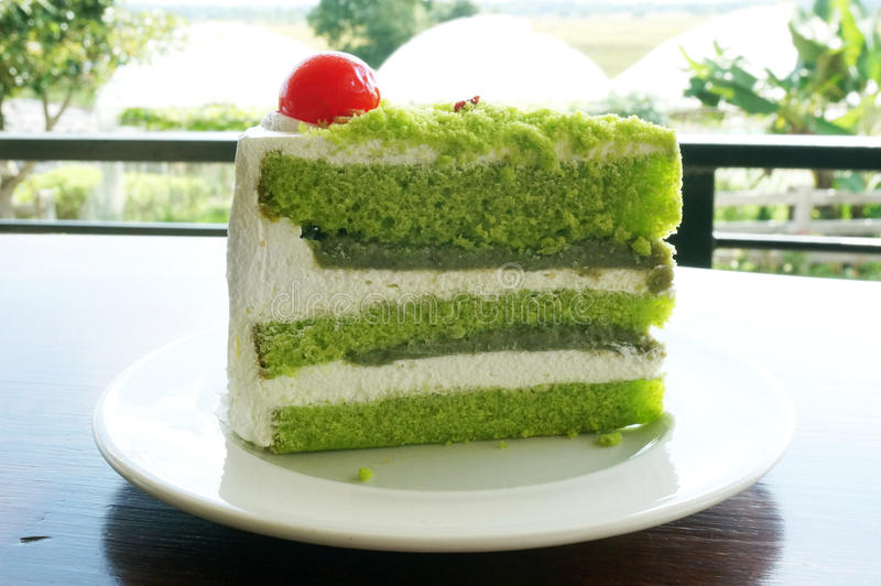 Colorful cream green tea cake stock photography
