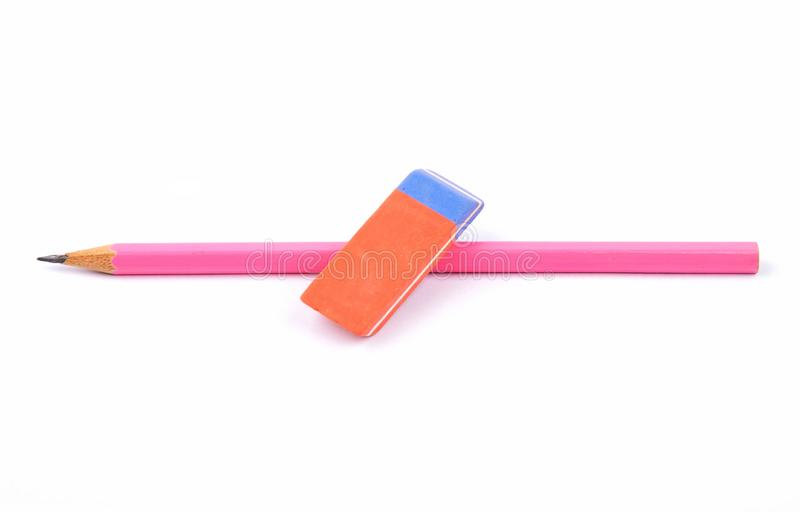 Sharpened pink pencil and eraser on white royalty free stock image