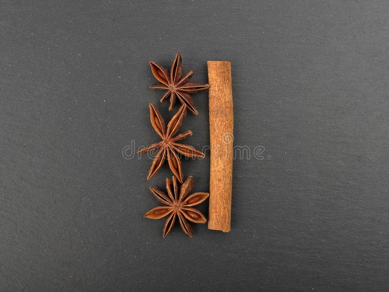 Star anis and cinnamon stick on shale. Colorful and crisp image of star anis and cinnamon stick on shale stock photography