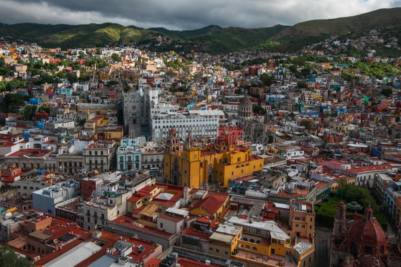 Colorful crowd american city buildings in hill, Guanajuato, Mexico. Colorful colonial architecture city in hill, which was built in silver mining age, with crowd stock image
