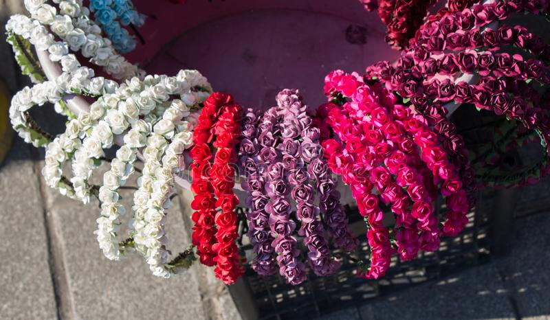 colorful crowns made of fake flowers stock photography