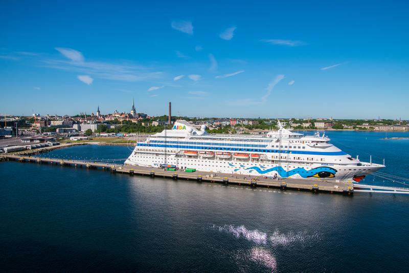 The colorful cruise ship AIDA Cara is seen docked and unloading tourists for a day in the quint tourist destination of Tallinn, Es. Tallinn Estonia - June 1 stock photos