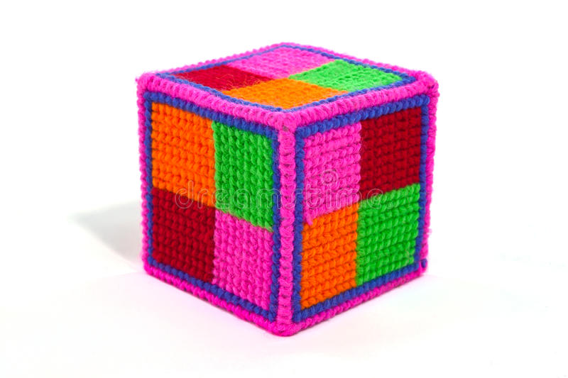 Colorful cube make from knitting wool. Isolate stock photography