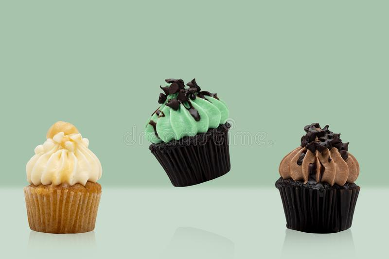 Colorful cupcake on green background, idea minimal concept for new year and christmas holliday.  royalty free stock image