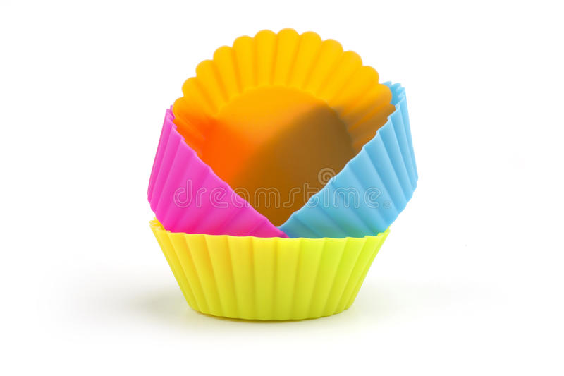 Colorful cupcake molds. Isolated on white background royalty free stock photo