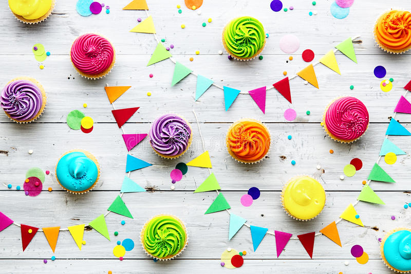 Colorful cupcake party background. With bunting stock photos