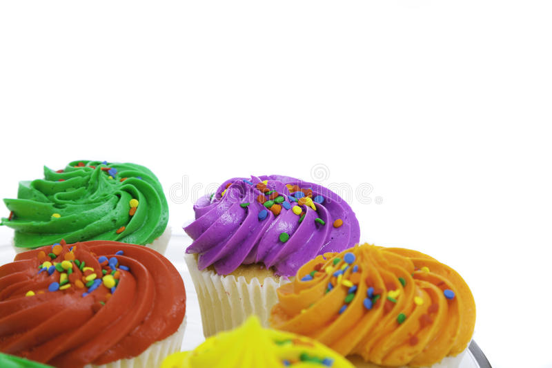 Colorful cupcakes on white background. A grou pf colorful cupcakes on a white background royalty free stock photos