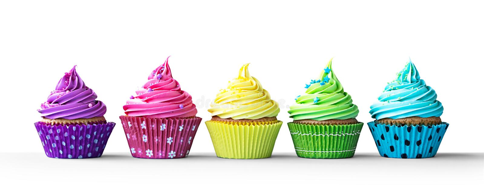 Colorful cupcakes on white. Row of colorful cupcakes isolated on a white background