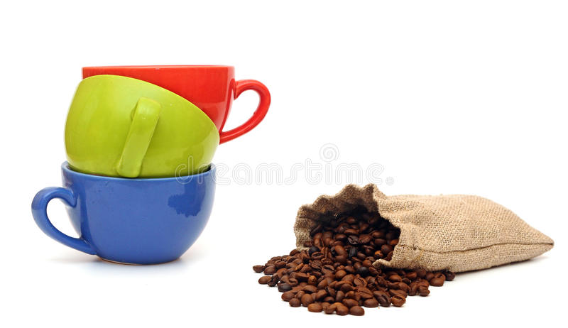 Colorful cups of coffee and beans royalty free stock photos