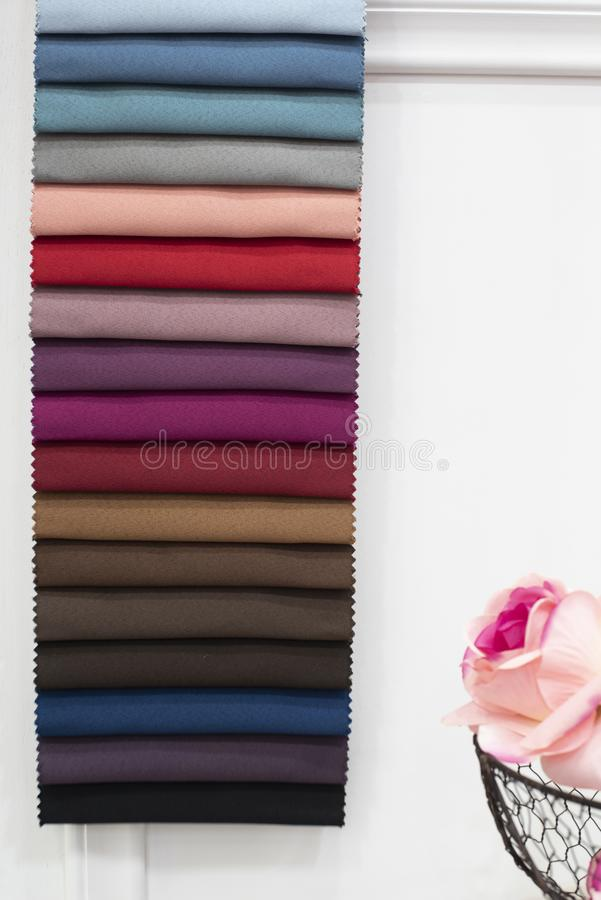 Colorful curtains fabric pattern palette texture samples as abstract textile background. Handmade, clothes and furniture. Decoration concept. Scraps of colored royalty free stock image