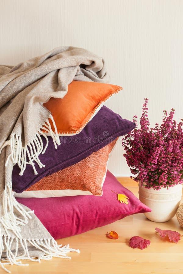 Colorful cushions throw cozy home autumn mood flower leaf stock photo