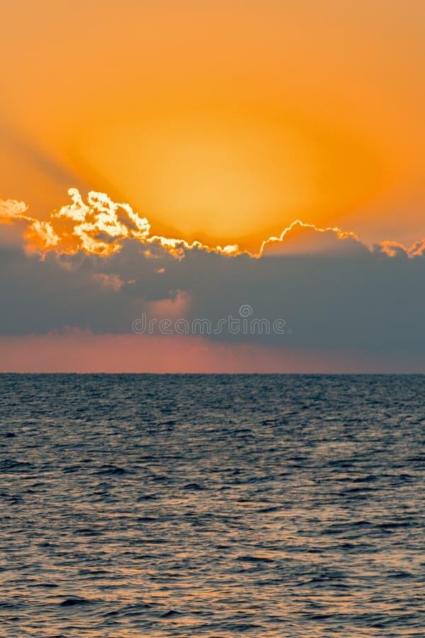 Colorful dawn over the sea, Sunset. Beautiful magic sunset over the sea. vertical photo. toned stock photo