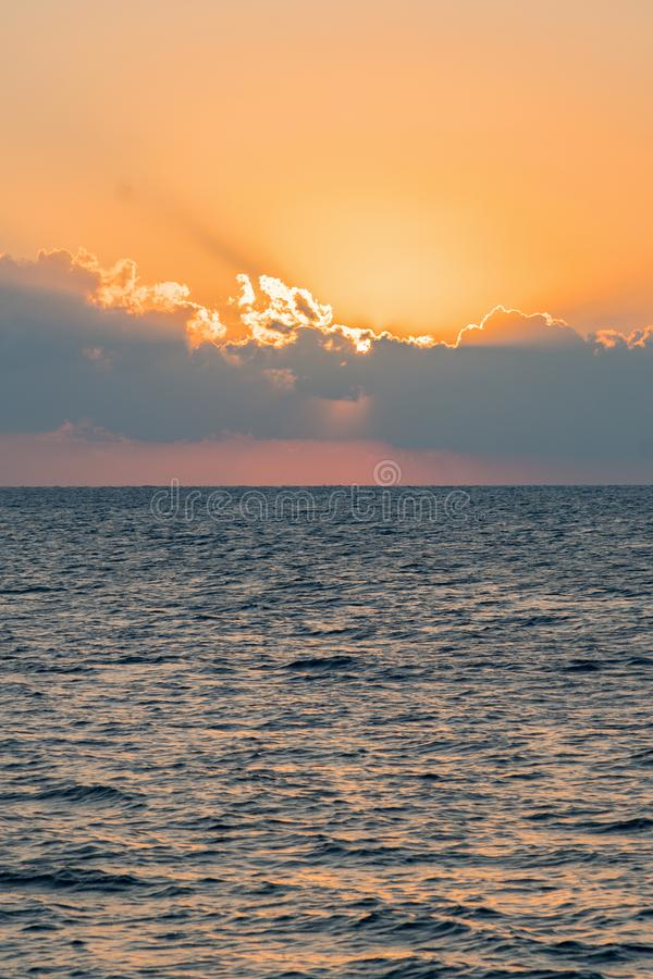 Colorful dawn over the sea, Sunset. Beautiful magic sunset over the sea. vertical photo. toned stock photography