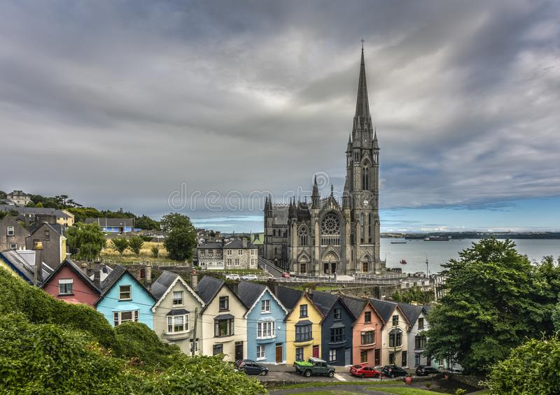 Colorful Deck of Cards Houses and St. Colman Cathedral, Cobh, County Cork, Ireland royalty free stock photos