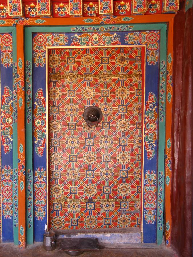 Colorful decorated closed door at Drepung monastery, Lhasa, Tibet, China. Beautifully painted, colorful decorated closed door at the Drepung monastery, Lhasa royalty free stock photos