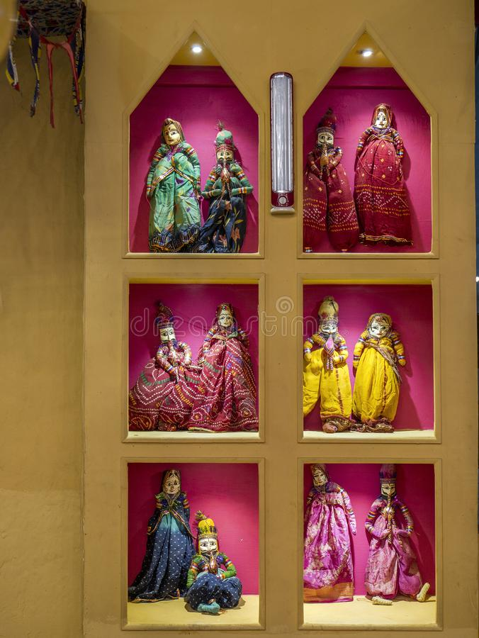Colorful decorated puppets in show window mumbai stock photos