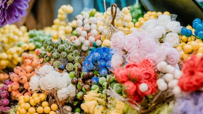 Colorful decoration artificial flower.  Artificial flower parts for creating bouquets royalty free stock photography