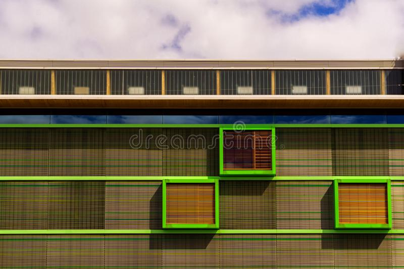 A colorful decoration on the upper part of a building. A colorful decoration on the upper part of a modern building royalty free stock photography