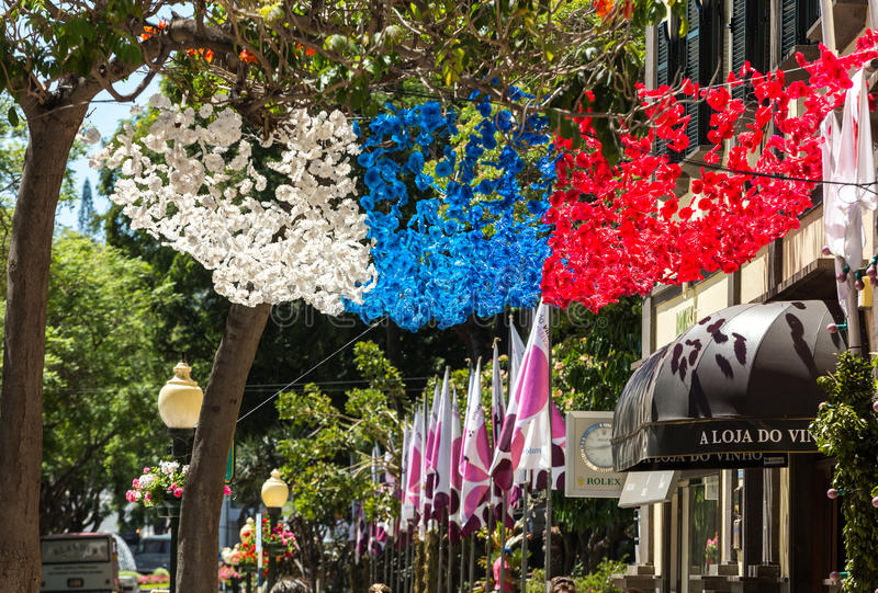 Colorful decorations from garlands over streets during the Madeira Wine Festival in Funchal on Madeira Island. royalty free stock images
