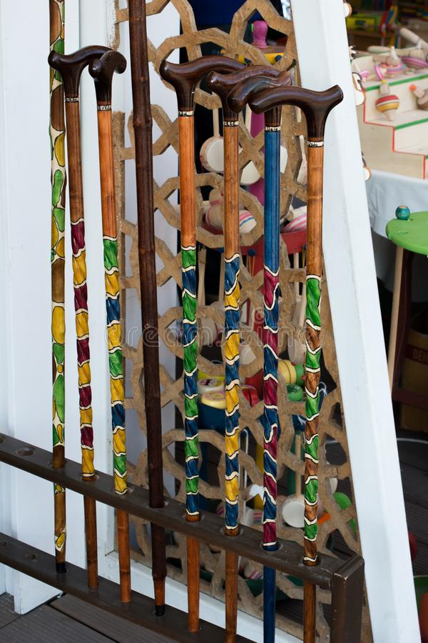 Colorful decorative wooden walking sticks on display. Colorful decorative wooden walking sticks in the view royalty free stock photos