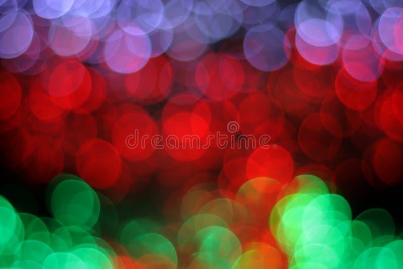 Colorful defocused bokeh lights background. Festive background with natural bokeh stock illustration