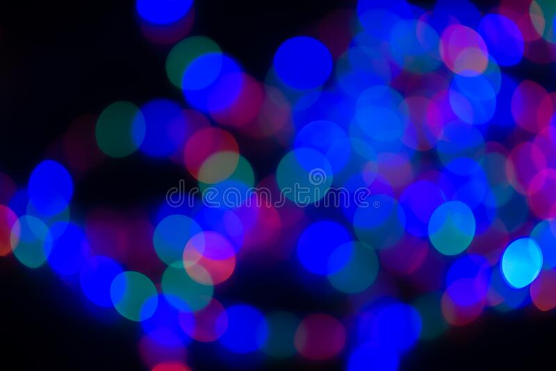 Colorful defocused lights in the city at night stock photo
