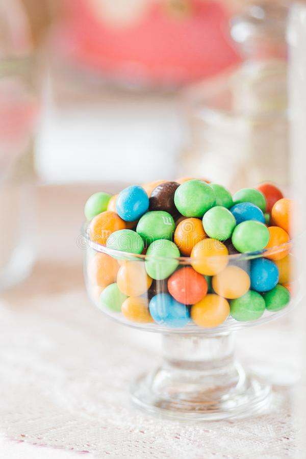 Colorful delicious candies staying in plate on table stock photo