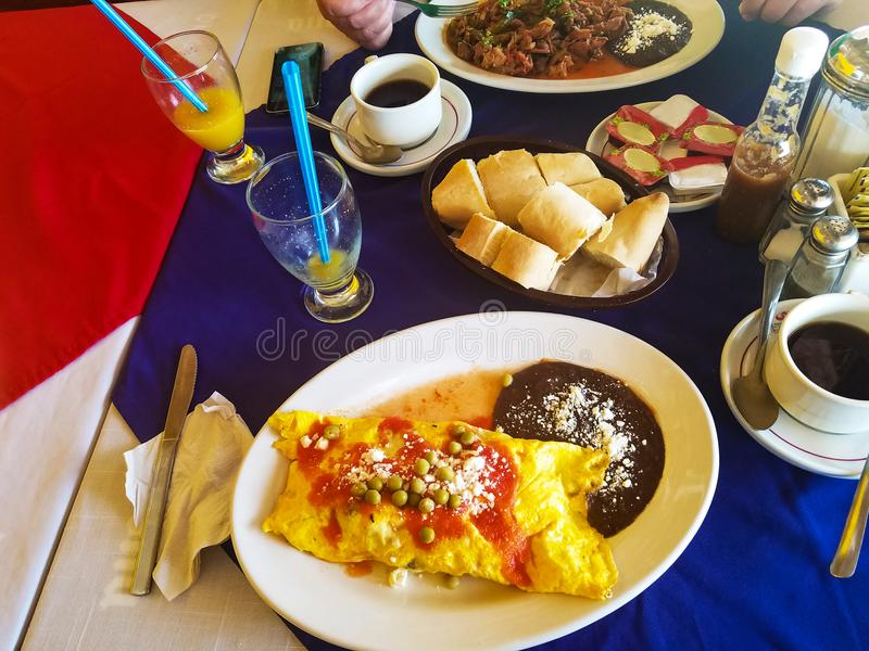 Colorful, delicious Mexican breakfast omlet with beans and rice in resturant. A Colorful, delicious Mexican breakfast omlet with beans and rice in resturant royalty free stock photos