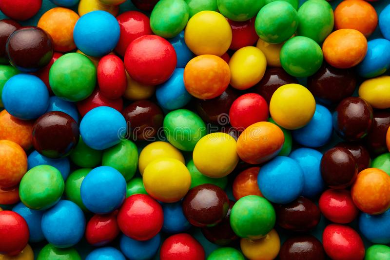 Colorful delicious sugar coated chocolate pills stock image