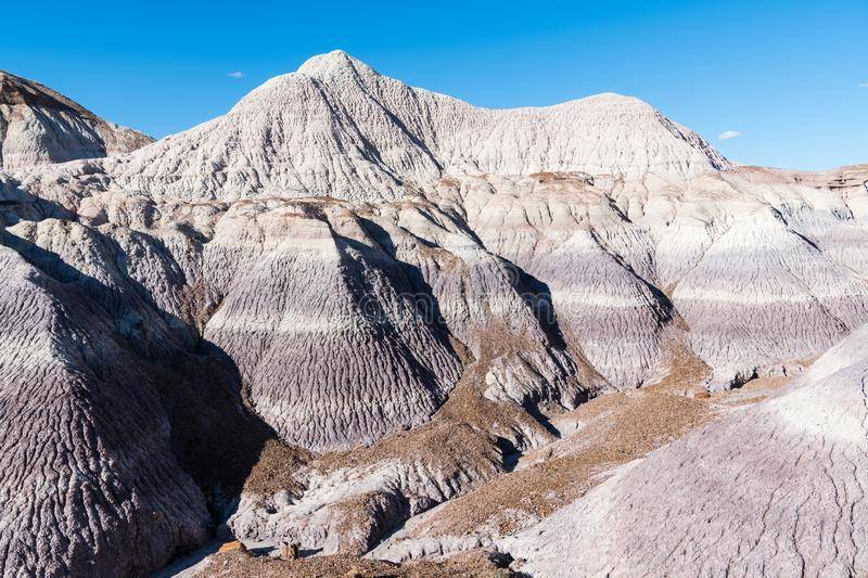Colorful desert mountain peaks with purple, gray, and brown strata in Petrified Forest National Park, Arizona stock photo