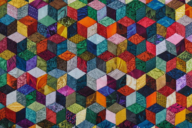 Colorful detail of quilt sewn from diamond pieces. Has view like three-dimensional stock photo