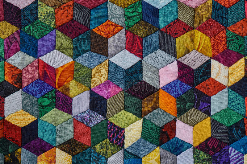Colorful detail of quilt sewn from diamond pieces. Has view like three-dimensional royalty free stock photo