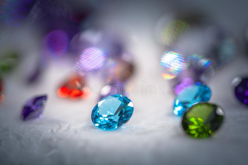 Colorful diamonds on turning Showcase. With snowing background stock photos