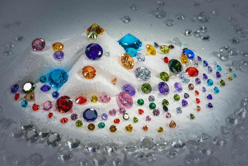 Colorful diamonds on turning Showcase. With snowing background stock photo