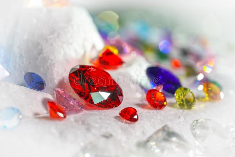 Colorful diamonds on turning Showcase. With snowing background royalty free stock image