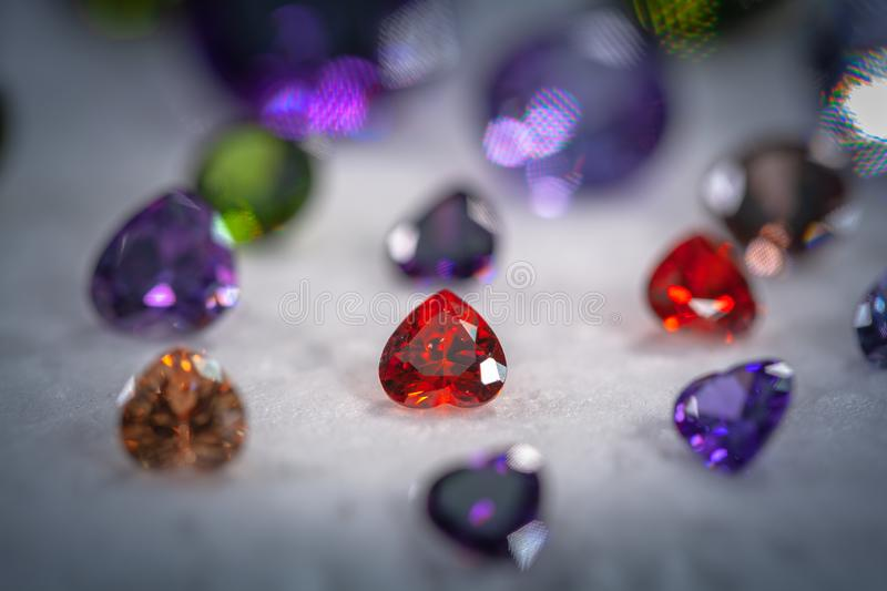 Colorful diamonds on turning Showcase. With snowing background royalty free stock images