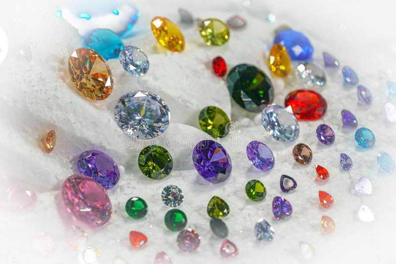 Colorful diamonds on turning Showcase. With snowing background royalty free stock photos