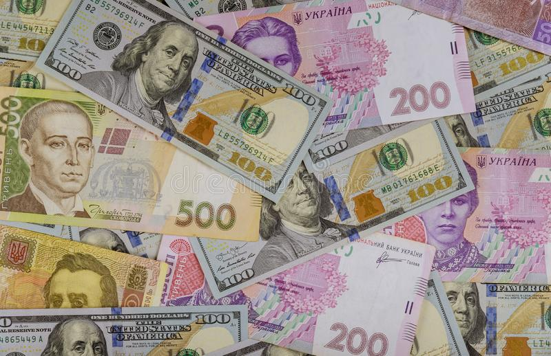 Colorful of different banknotes Ukrainian national currency bills and American dollars money and finances investment concept stock photos