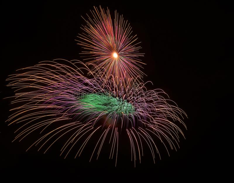 Colorful different colors, amazing fireworks in Malta, dark sky background and house light in the far, Independence day, fireworks stock photography